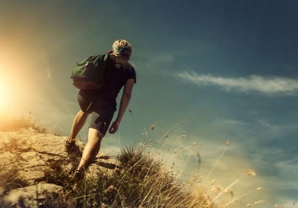 54994459 - man climb on mountain hill